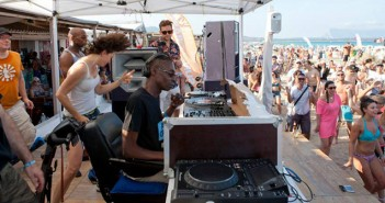 Zy:on aka Brian Belle Fortune DJing on the beach in Sardinia at SunAndBass 2014